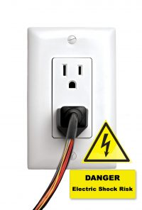 Cord plugged in outlet with wires exposed